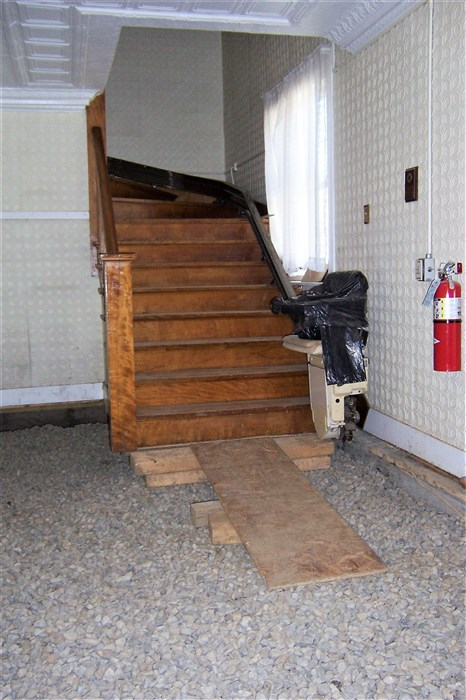 Entryway and entrance to the stairs on the East side.