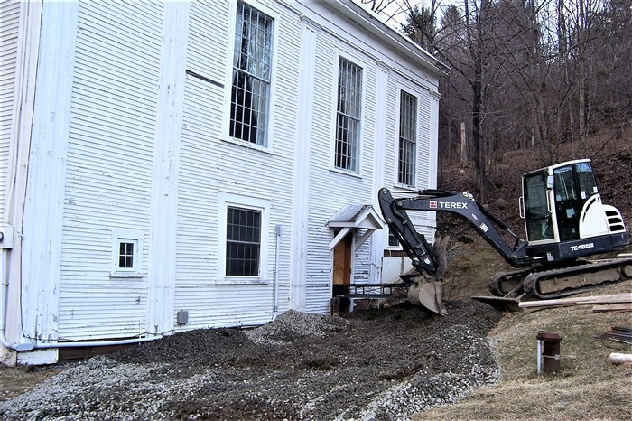 East side of the church from which the stones are being moved into the basement.