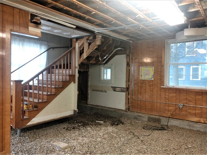 The inner walls of the old bathroom and a piece of the dining room wall have been removed in order to accommodate a larger space for the handicapped accessible bathroom.